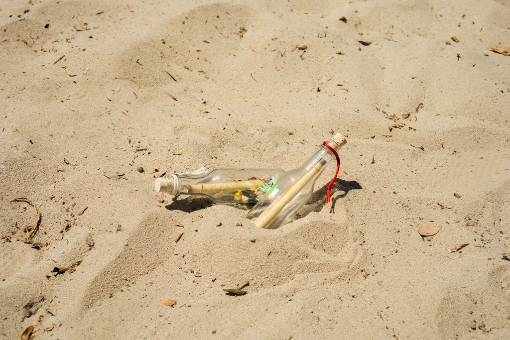 two message in a bottle on the beach